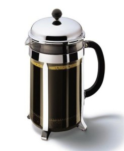 French press with coffee in it.